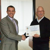 Past Chair Ned Smith presents for the City of Tustin to Jeffrey Hakim