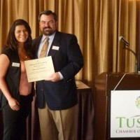 Alessandra Sanchez gets recognized by the Tustin Chamber Chairman Jonathan Stone for her service as Ambassador of the Month for the Tustin Chamber.
