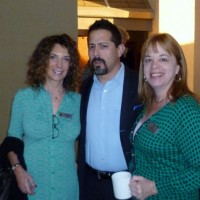 Elise Perkins hob nobs with fellow Get Safe member David Monderine and Lisa Gross sporting the Leprechaun Leap green.