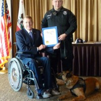 Lake Forest Mayor and Assemblyman Donald Wagner's right hand man Scott Voight delivers a certificate of recognition to Police Officer of the Month Rene Barraza and his K9 partner Bravo.